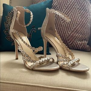 Gold strappy heels with studs